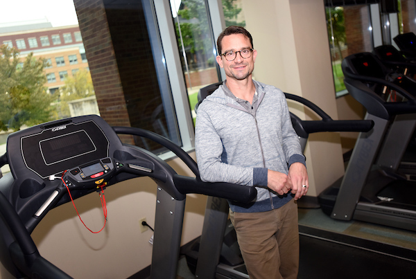 Sutton beside treadmill