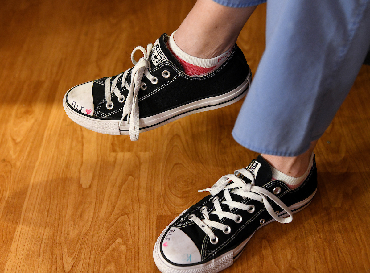 three letters written on the white tips of Fiege's black Converse sneakers: RLF. Rachael Leigh Fiege