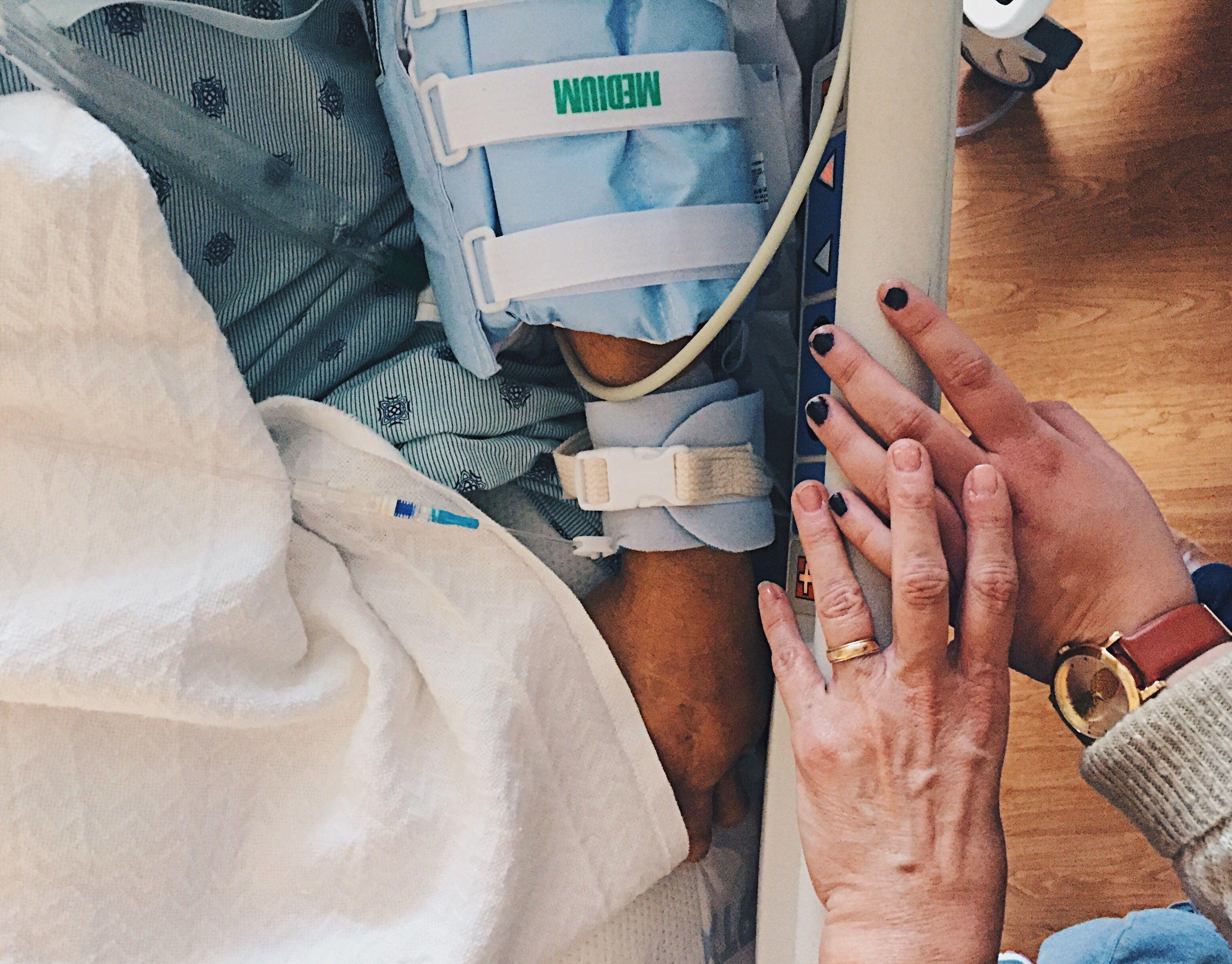hands at bedside
