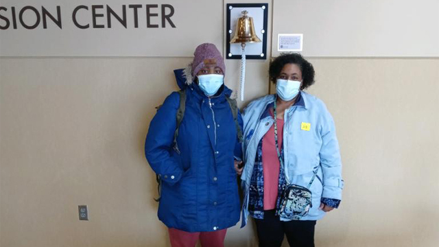 Individuals pose in front of IU Health's Infusion Center