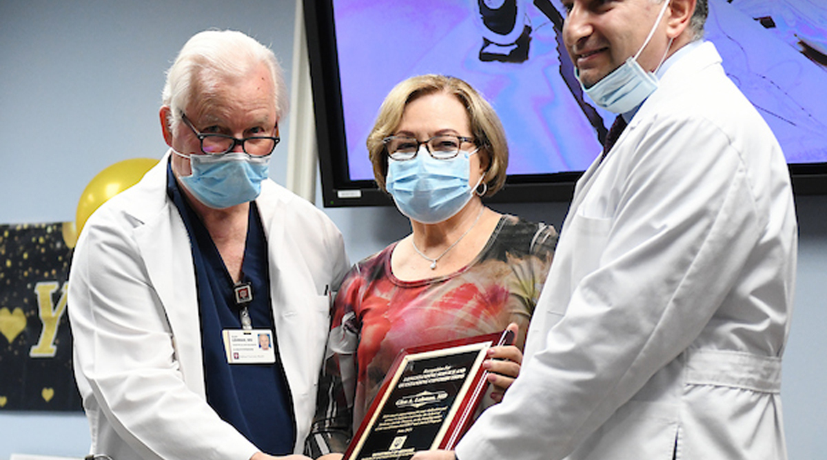 Dr. Glen Lehman receives an award for his work with gastrointestinal procedures