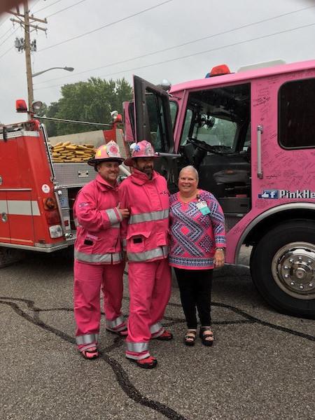 Rhonda Jones with Pink Heals in front of fire truck