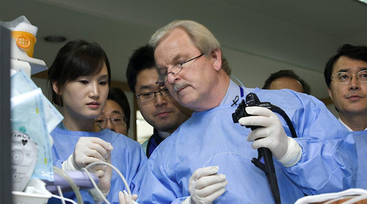 Dr. Glen Lehman working alongside team members