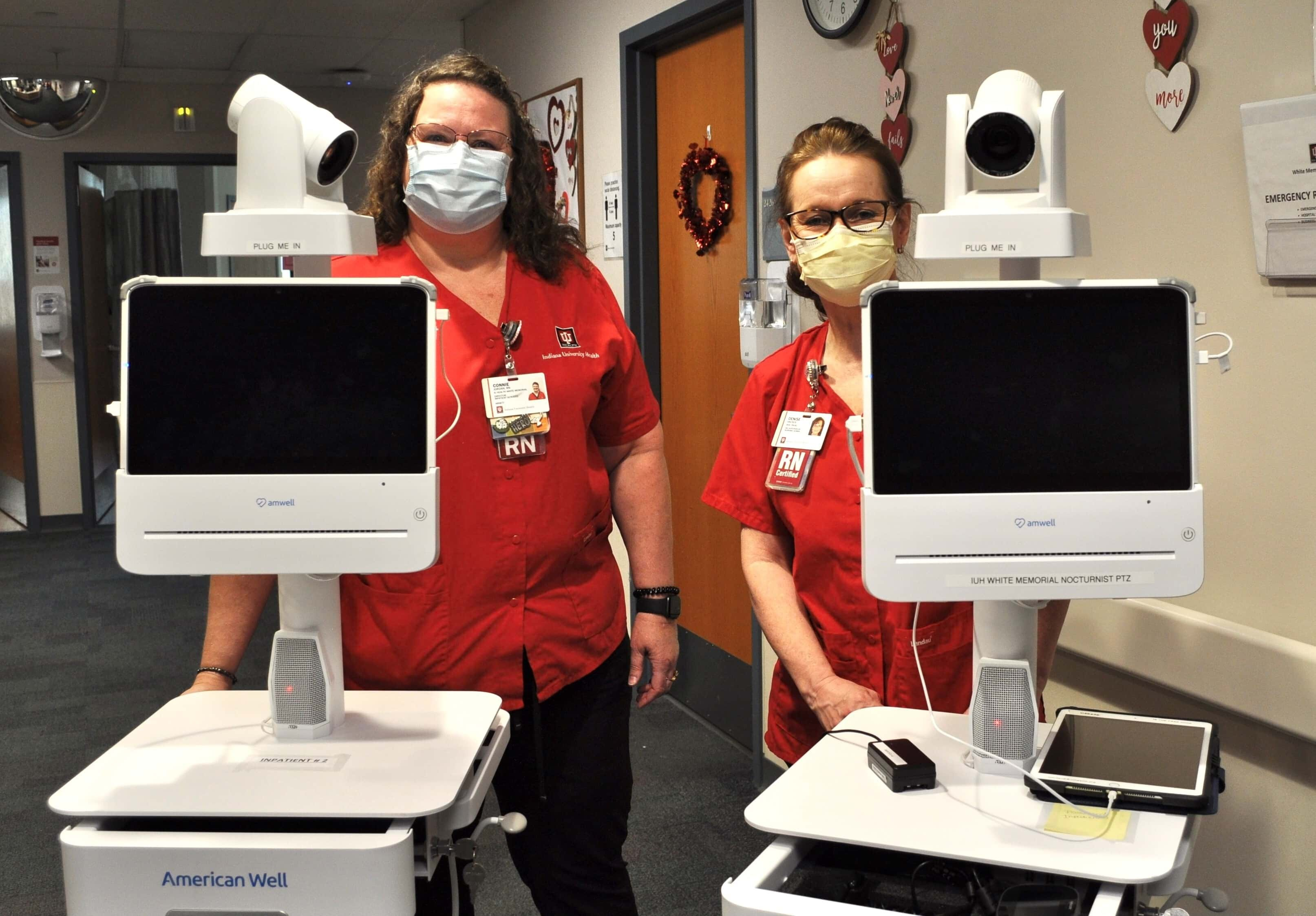 Telehealth healthcare workers showcasing new telecommunications technologies