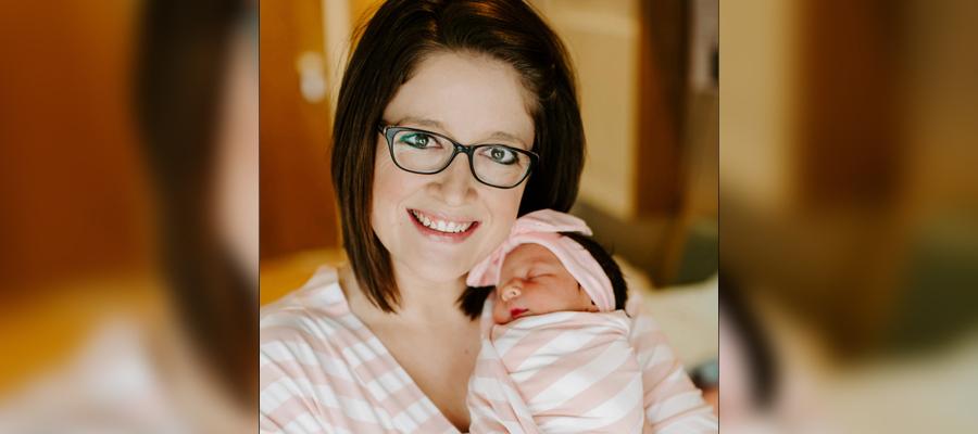 Alyson holding her baby