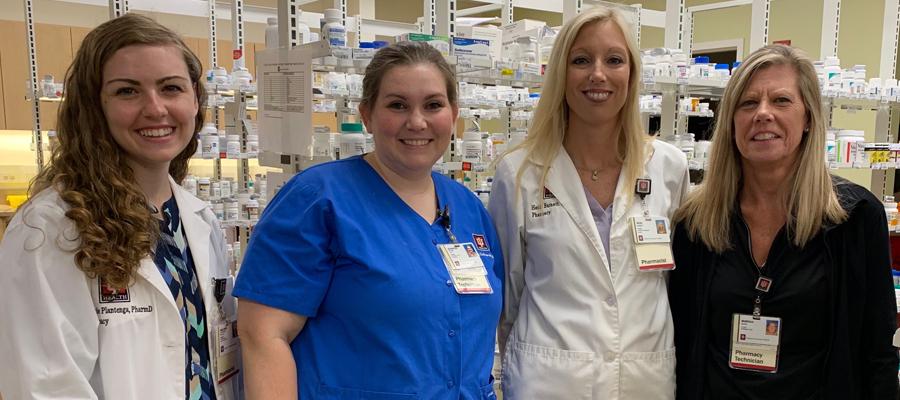 Barnett with pharmacist coworkers