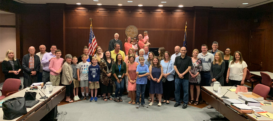 Court room with the Cains, family, and friends