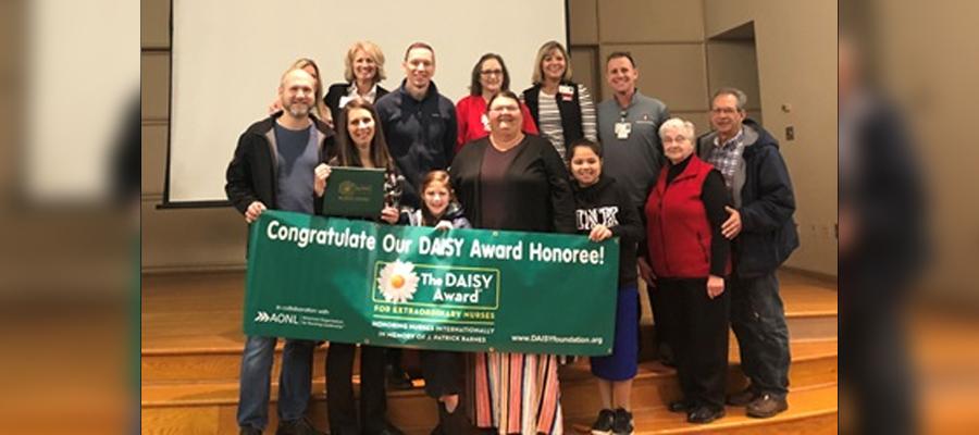 Traci receiving the Daisy Award