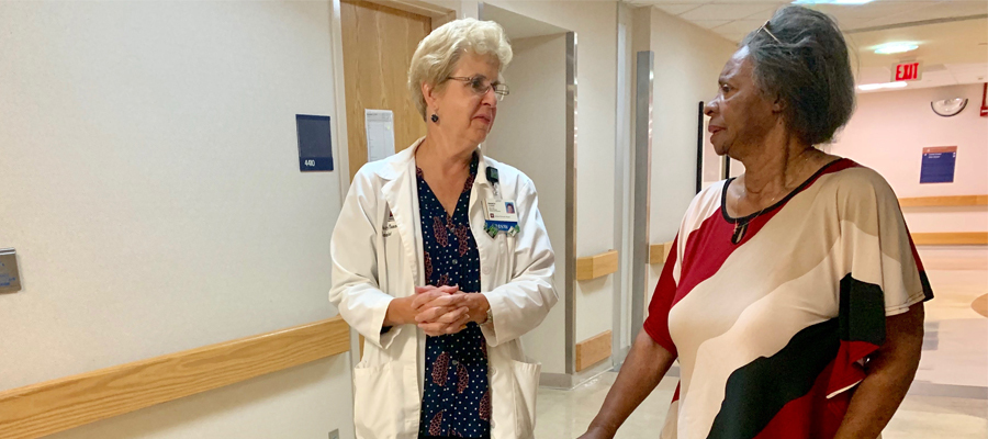 Nurse Practitioner Tony Davey and Flamme walk through IU Health University Hospital