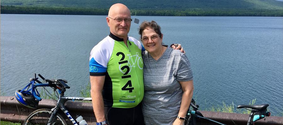 Linda and Jeff biking together
