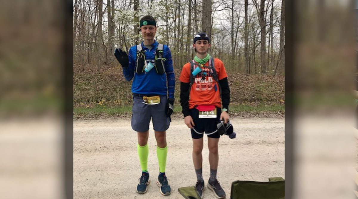 McCartney and Elijah posing in running gear