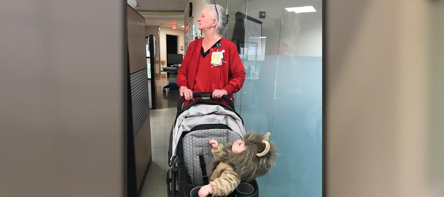 Harris pushing a stroller