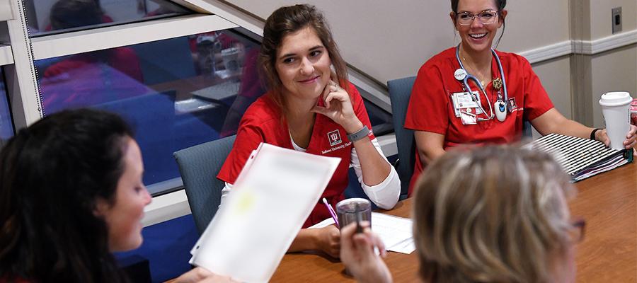 Rachel Ketelaar in her red scrubs at IU Health Methodist Hospital