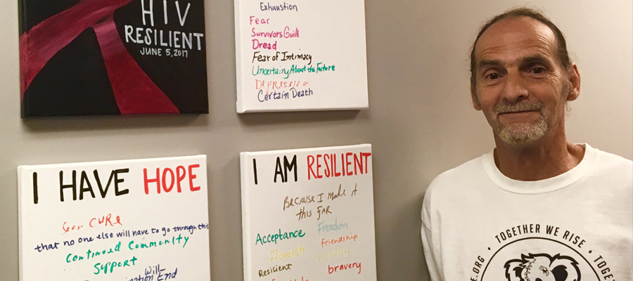 Dyer next to HIV Resilient paintings