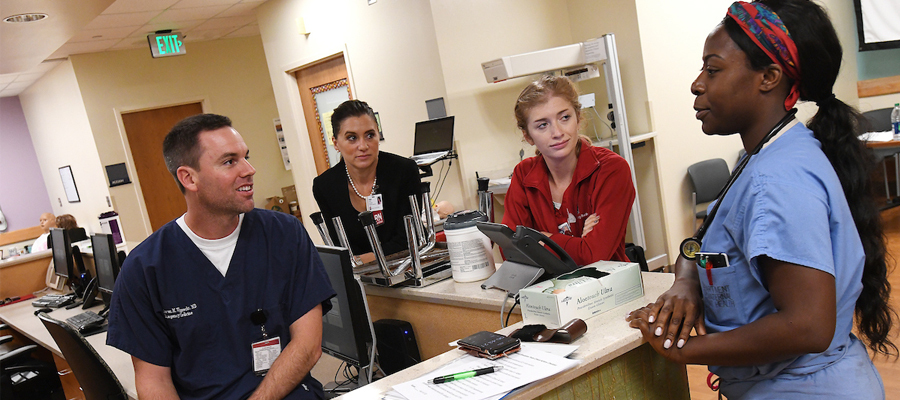 IU Health staff converse