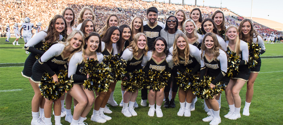 Walker posing with the rest of the Purdue dance team
