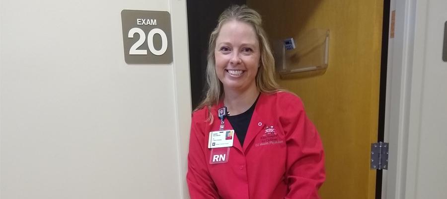 Sara Richman, RN in her red scrubs