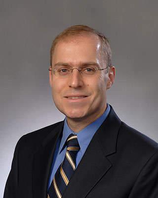 Charles J Kahi, MD