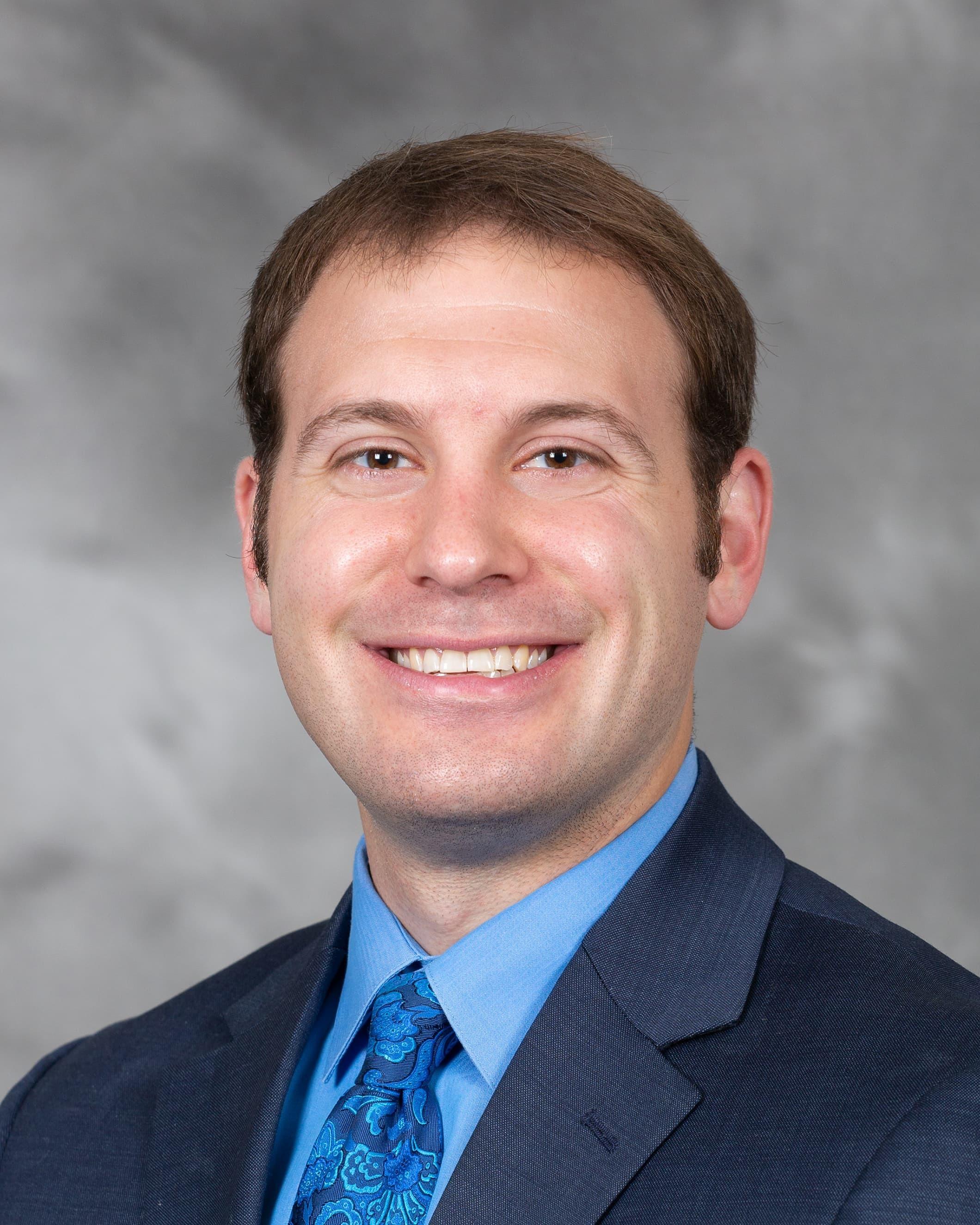 Adam R Harker, MD