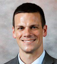 Travis J. Dams, MD